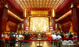 People Pray in Buddhist Temple in Singapore. People Pray in Buddhist Temple when Sunday in Singapore Royalty Free Stock Image