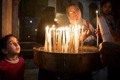 People pray in church and put candles royalty free stock image