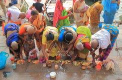 Ganges river ghat Varanasi India. People pray in Ganges river ghat in Varanasi India Royalty Free Stock Image
