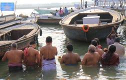Ganges river ghat Varanasi India. People pray in Ganges river ghat in Varanasi India Stock Image