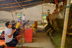 People that pray homage to public ancient Thai Buddha statue left in temple. Royalty Free Stock Images
