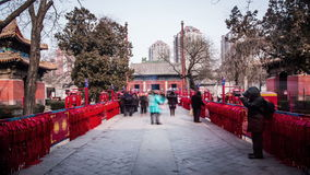 People pray for their good luck by hanging red board at Dongyue Temple during Spring Festival in Beijing Royalty Free Stock Photos