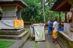 People praying at the Elephant temple in Bali, Indonesia Stock Photo