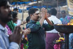People praying in front of the Tiruvannamalai temple. Tiruvannamalai in Tamil Nadu, India, January 31, 2018: People praying in front of the Tiruvannamalai temple royalty free stock image