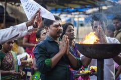 People praying in front of the Tiruvannamalai temple. Tiruvannamalai in Tamil Nadu, India, January 31, 2018: People praying in front of the Tiruvannamalai temple stock photography