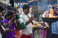 People praying in front of the Tiruvannamalai temple. Tiruvannamalai in Tamil Nadu, India, January 31, 2018: People praying in front of the Tiruvannamalai temple stock images