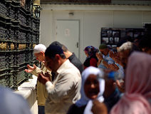 People praying in front of the tomb, Stock Images