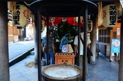 People praying Fudomyoo statue Royalty Free Stock Image