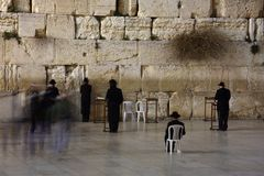People praying at the holiest Jewish site - Western/Wailing wall at night Stock Photos