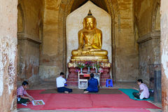 People praying inside the Dhammayangyi Temple in Bagan, Myanmar Royalty Free Stock Image