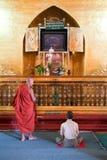 People praying at Mahamuni Buddha temple in Mandalay, Myanmar Stock Photos