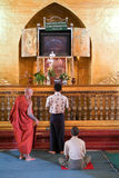 People praying at Mahamuni Buddha temple in Mandalay, Myanmar Stock Images