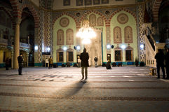 People Praying in Mosque Stock Image