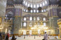 People praying in the New Valide Sultan Mosque Stock Image