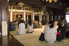 People praying at the Nishi-Honganji Temple in Japan Royalty Free Stock Photo