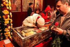 People praying at the relics. Of Saint Dimitrie the New source of mir at the Romanian Patriarchate on the hill in Bucharest, Romania Stock Image
