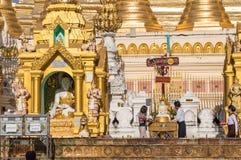 People praying at Shwedagon Pagoda, Yangon, Burma Myanmar Stock Images