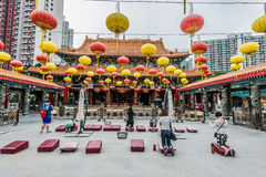 People praying Sik Sik Yuen Wong Tai Sin Temple Kowloon Hong Kon Stock Photo