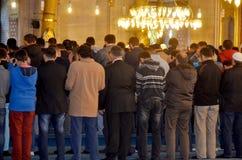 People praying at Suleymaniye Mosque. ISTANBUL, TURKEY SEPTEMBER 26: People praying at Suleymaniye Mosque on September 28, 2013 Istanbul in Turkey. The Stock Photos