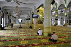 Praying at the Sultan Mosque, in Singapore. People praying at the Sultan Mosque, in Singapore royalty free stock photos