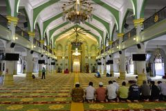Praying at the Sultan Mosque, in Singapore. People praying at the Sultan Mosque, in Singapore stock image