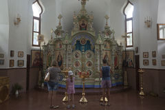 People praying in a temple in honor of the icon Mother of God Semistrelnaya in the Trinity-Georgievsky female monastery Stock Photo