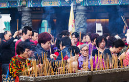 People Praying at Temple Stock Image