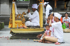 People praying at Tirta Empul Hindu Temple of Bali on Indonesia Stock Images