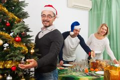 People preparing for celebrating Christmas. At home Stock Photography