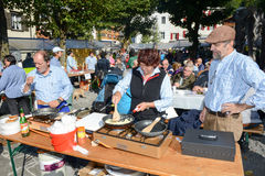 People preparing food at the autumn festival at Engelberg Stock Images