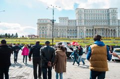 People present at Bucharest Auto Show on April 4 2015 in front of the Palace of the Parliament Stock Photos