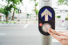 People press on crossing road sign Stock Photo