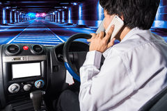 People press the phone while driving/edit background tunnel Royalty Free Stock Images