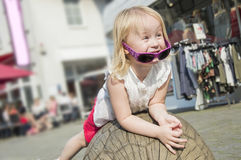 People.Pretty little girl with curly blond hair playing outdoors on a sunny summer day. Pretty little girl with curly blond hair playing outdoors on a sunny Royalty Free Stock Image