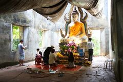 People preying buddha statute in temple. Stock Photo