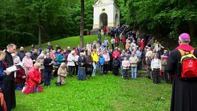 People priest pray to Christ suffering stations. Pentecost. 4K. VILNIUS, LITHUANIA - JUNE 02, 2017: people priest flock to pray to Christ suffering stations stock video footage