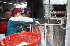 People processing Kudzu flour Royalty Free Stock Photos