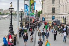 People at promenade between London Eye and Westminster Bridge, L. LONDON, ENGLAND - JUNE 08, 2017: People at promenade between London Eye and Westminster Bridge stock photos