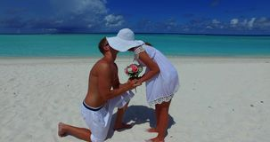 2 people proposal marriage romantic young couple holding hands on a tropical island of white sand beach and. Two 2 people proposal marriage romantic young couple stock video footage