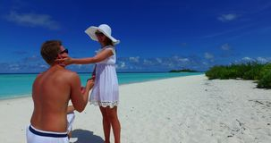 2 people proposal marriage romantic young couple holding hands on a tropical island of white sand beach and. Two 2 people proposal marriage romantic young couple stock footage