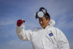People in protective clothing. Defines environmental analyzes Stock Photo