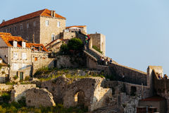 People on a protective wall in the old city of Dubrovnik, Croatia Stock Photo