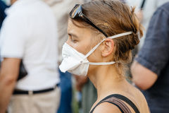 People protesting against air pollution. STRASBOURG, FRANCE - AUG 6, 2015: People wearing air masks protesting against air pollution in Strasbourg, Alsace Stock Images
