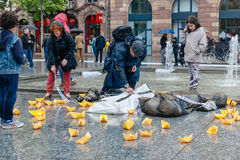 People protesting manifestation die-in against immigration policy and border management. STRASBOURG, FRANCE - APR 26 2015 Arranging Frontex line over dead corps royalty free stock photos