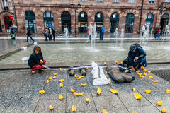 People protesting manifestation die-in against immigration policy and border management. STRASBOURG, FRANCE - APR 26 2015 Arranging Frontex line over dead corps stock photography