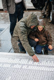 People protesting manifestation die-in against immigration policy and border management. STRASBOURG, FRANCE - APR 26 2015: Dad and son at protest against royalty free stock photos