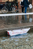 People protesting manifestation die-in against immigration policy and border management. STRASBOURG, FRANCE - APR 26 2015: Freedom not frontex boat in fountain royalty free stock photos