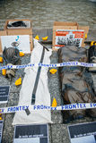 People protesting manifestation die-in against immigration policy and border management. STRASBOURG, FRANCE - APR 26 2015: Frontex protest against immigration stock photos