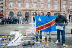 People protesting manifestation die-in against immigration policy and border management. STRASBOURG, FRANCE - APR 26 2015: Group photo of people during protest royalty free stock photos