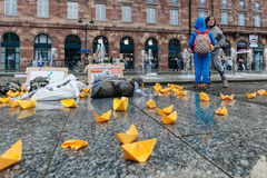 People protesting manifestation die-in against immigration policy and border management. STRASBOURG, FRANCE - APR 26 2015: Kids looking at fountain during royalty free stock images